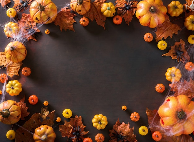 Halloween decoration on old paper texture black frame background top view with copy space