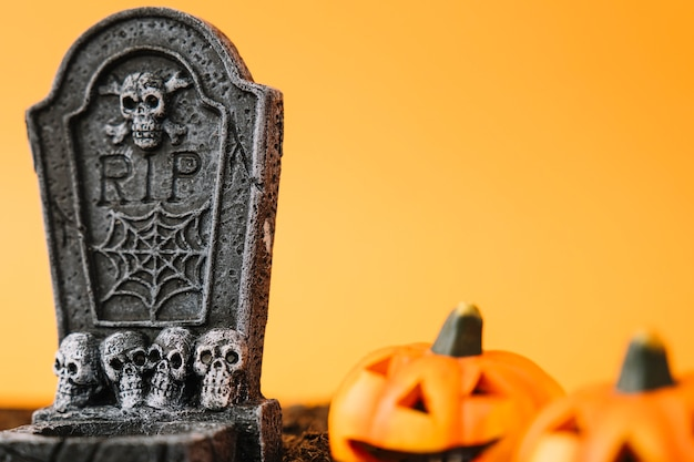 Halloween decoration with grave stone and pumpkins