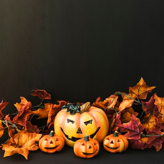 Halloween decoration with pumpkin and autumn leaves