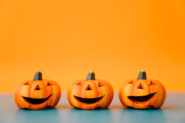 Halloween decoration with three laughing pumpkins