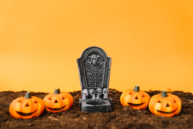 Halloween decoration with tombstone and pumpkins