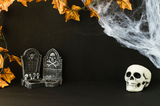 Halloween decoration with tombstones and skull