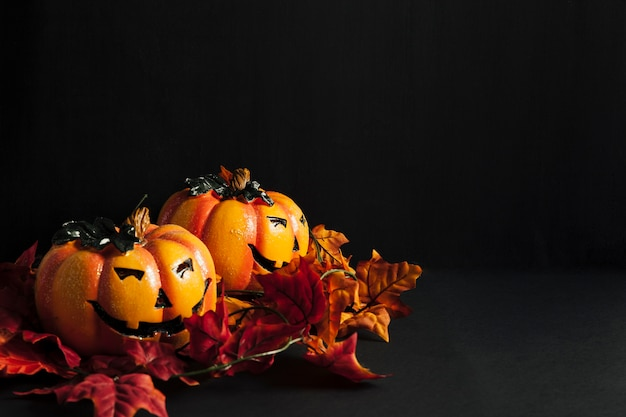Halloween decoration with two pumpkins and autumn leaves