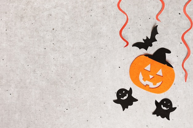 Halloween decorations on gray background. copy space