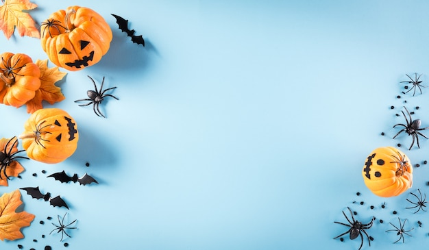 Halloween decorations made from pumpkin, paper bats and black spider