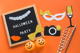 Halloween decorations near frame with writing