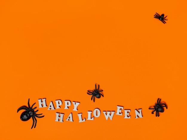 비문 해피 할로윈과 거미와 오렌지 배경에 할로윈 장식