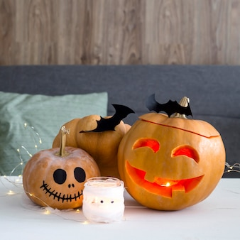 Halloween decorations - pumpkins and bats with a ghost candlestick