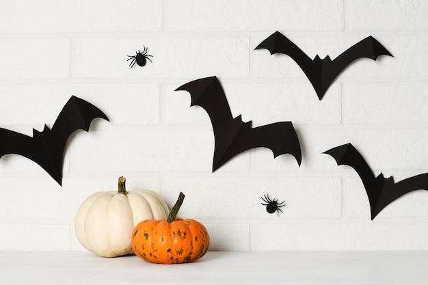 Halloween decorations on white brick wall