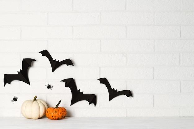 Halloween decorations on white brick wall
