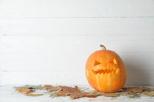 Halloween decorative pumpkin on wooden table, copy space