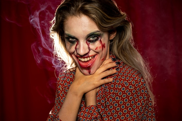 Halloween female model choking with her own hands photo shooting