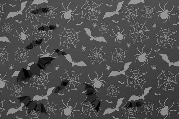 ハロウィーンのお祭りの背景と装飾の概念-コウモリの飛行