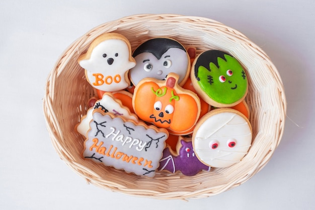 Halloween funny cookies in wooden basket. trick or threat, happy halloween, hello october, fall autumn, festive, party and holiday concept