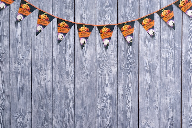 Halloween garland on wooden background