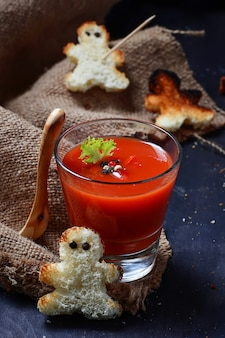 Halloween gazpacho soup and croutons that look like voodoo