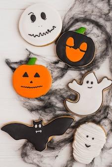 Halloween gingerbread between black cobweb