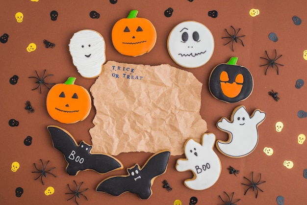 Halloween gingerbreads around wrinkled craft paper