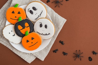 Halloween gingerbreads on dish placed on linen cloth