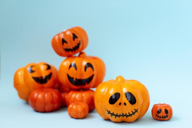 Halloween glitter pumpkin jack o lantern decor with funny faces.