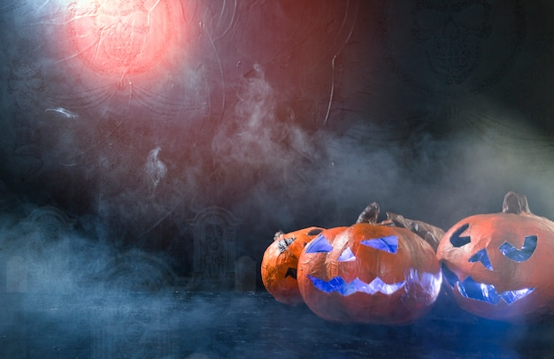Halloween handmade pumpkins illuminated inside lying on side with smoke