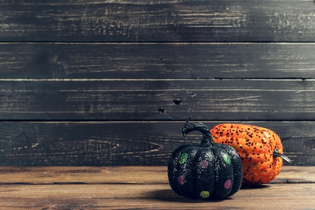 Halloween holiday background with pumpkin on wooden table