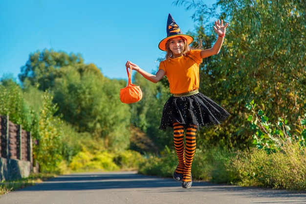 Halloween holiday, child girl in costume. selective focus.