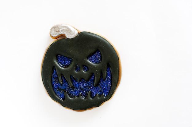 Halloween holiday concept. sweet gingerbread pumpkin of black color.