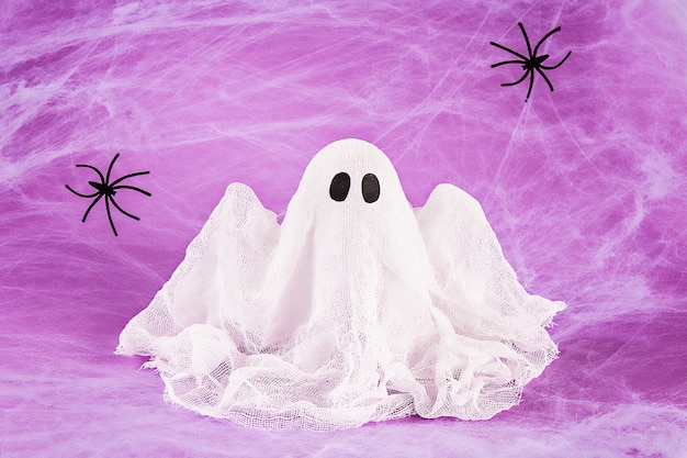 Halloween holiday concept. white spider web with two black spider web. diy ghost