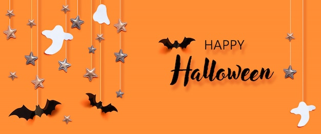 Halloween holiday concept with bats, ghost, spider web, stars over a orange