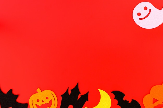 Halloween holiday decorations on red background.