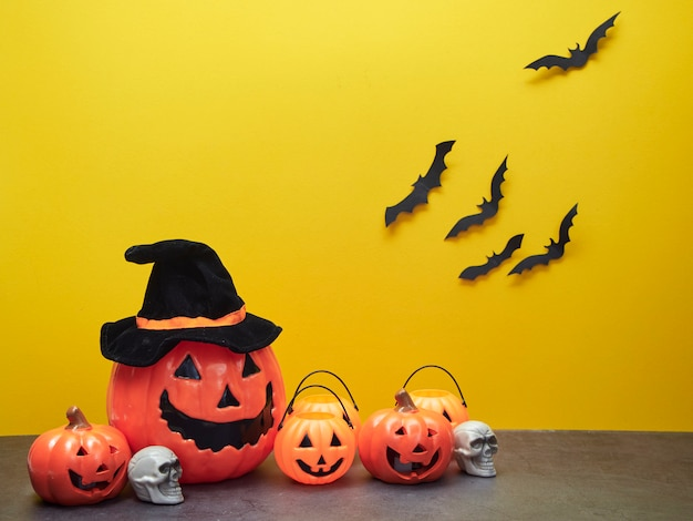 Halloween holiday ideas, pumpkin decorations and black bats yellow.