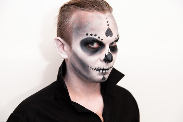 Halloween holiday, portrait of a man with makeup.