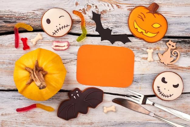 ハロウィーンの休日のお菓子の背景。