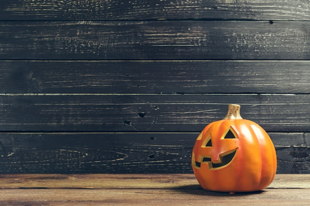 Halloween holiday with pumpkin on wooden table
