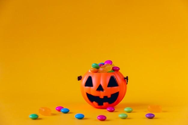 Halloween jack o lantern bucket filled with candies