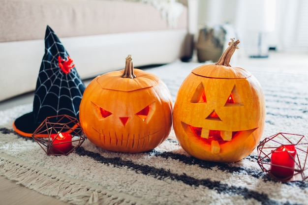 Halloween jack-o-lantern pumpkins, home decorated with traditional halloween symbols.