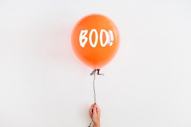 Halloween minimal concept. one orange balloon on white