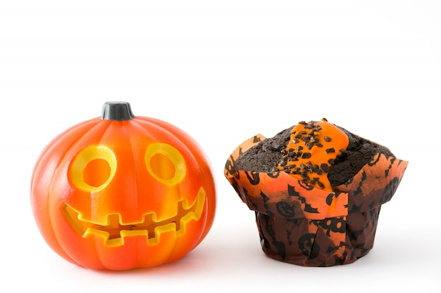 Halloween muffins and pumpkin isolated on white