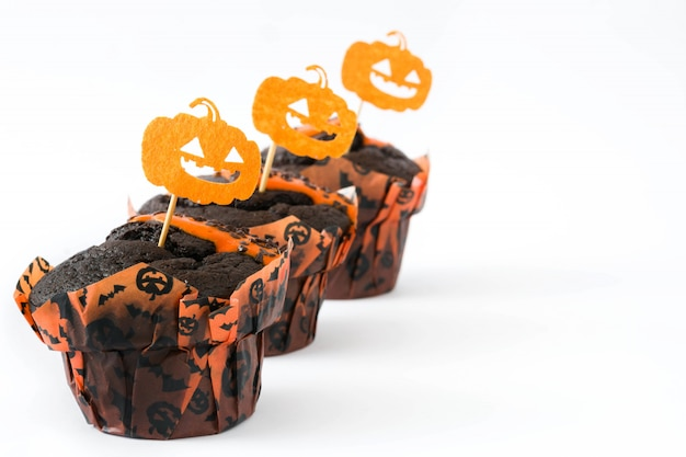 Halloween muffins with pumpkins decorate isolated on white