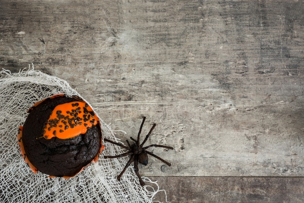 Halloween muffins on a wooden table