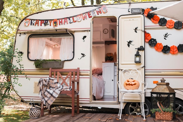 Halloween outdoors arrangement with caravan