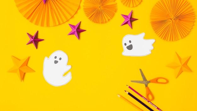 Halloween paper craft flat lay.children seasonal art table top view.kids hand craft concept.