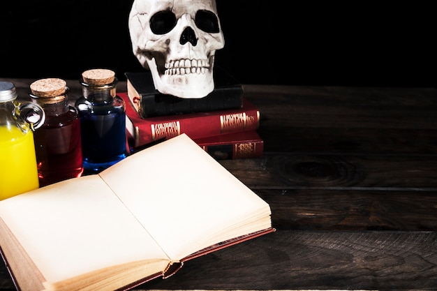 Halloween potions and books on desk