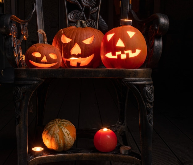 Halloween preperation, pumpkins with candles inside illuminating in the dark