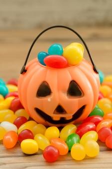 Halloween pumpkin basket full of candies