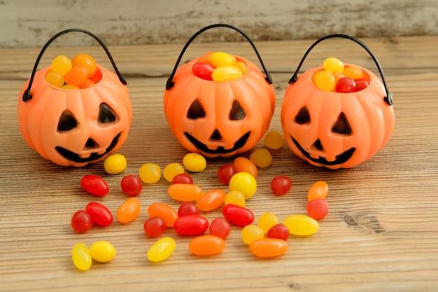 Halloween pumpkin baskets full of candies