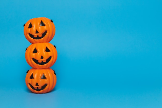 Halloween pumpkin on a blue background and copy space, side view