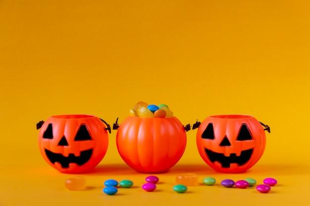 Halloween pumpkin bucket with candies