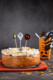 Halloween  pumpkin cheesecake with marshmallow meringue topping decorated